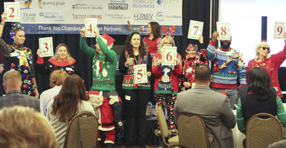 Chamber members participate in an ugly sweater contest